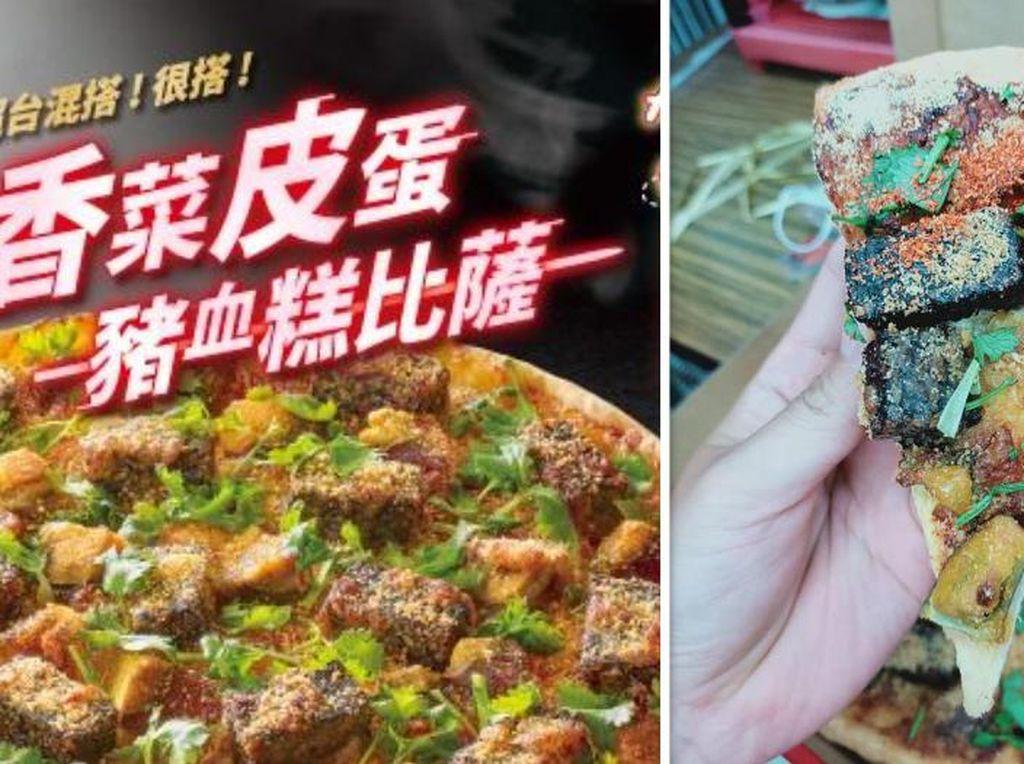Gerai Pizza Ini Luncurkan Pizza Topping Telur Pitan dan Darah Babi