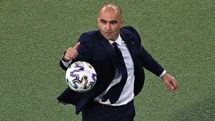 MUNICH, GERMANY - JULY 02: Roberto Martinez, Head Coach of Belgium attempts to catch the Adidas Uniforia match ball during the UEFA Euro 2020 Championship Quarter-final match between Belgium and Italy at Football Arena Munich on July 02, 2021 in Munich, Germany. (Photo by Stuart Franklin/Getty Images)