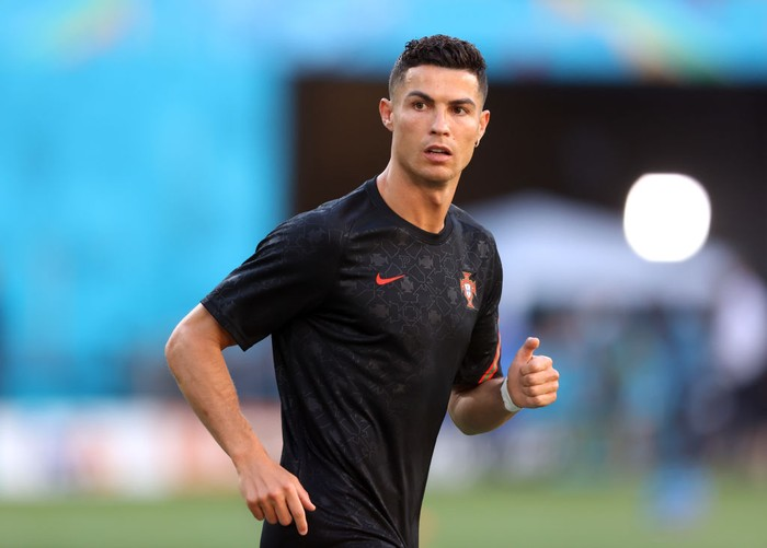 SEVILLE, SPAIN - JUNE 27: Cristiano Ronaldo of Portugal looks on as he warms up prior to the UEFA Euro 2020 Championship Round of 16 match between Belgium and Portugal at Estadio La Cartuja on June 27, 2021 in Seville, Spain. (Photo by Alexander Hassenstein/Getty Images)