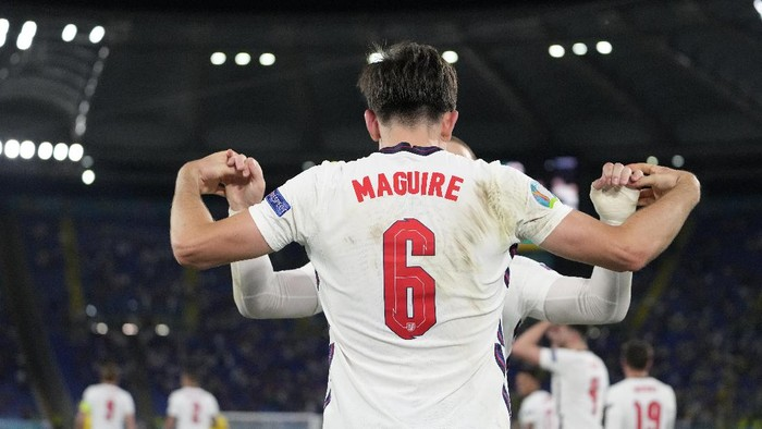 Englands Harry Maguire celebrates after scoring his sides second goal during the Euro 2020 soccer championship quarterfinal match between Ukraine and England at the Olympic stadium in Rome at the Olympic stadium in Rome, Italy, Saturday, July 3, 2021. (AP Photo/Alessandra Tarantino, Pool)