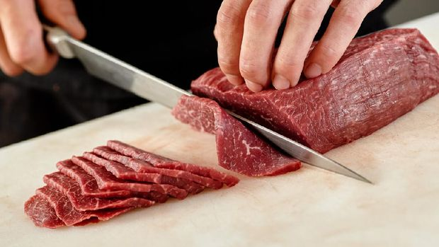 Japanese man slicing meat