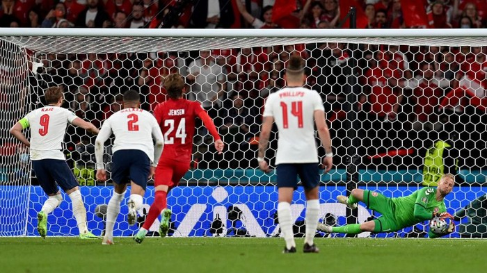 LONDON, ENGLAND - JULY 07: Harry Kane of England has a penalty saved by Kasper Schmeichel of Denmark, before he goes on to score the rebound for his teams second goal during the UEFA Euro 2020 Championship Semi-final match between England and Denmark at Wembley Stadium on July 07, 2021 in London, England. (Photo by Paul Ellis - Pool/Getty Images)