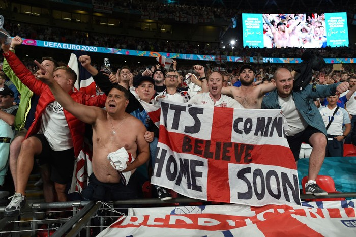 LONDON, ENGLAND - JULY 07: Fans of England celebrate their sides victory after the UEFA Euro 2020 Championship Semi-final match between England and Denmark at Wembley Stadium on July 07, 2021 in London, England. (Photo by Paul Ellis - Pool/Getty Images)
