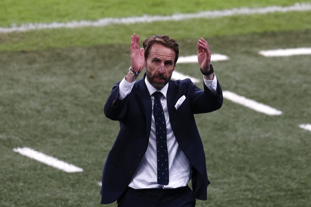 England's manager Gareth Southgate applauds the fans at the end of the Euro 2020 soccer championship semifinal match between England and Denmark at Wembley stadium in London, Wednesday, July 7, 2021. England won 2-1. (Catherine Ivill/Pool Photo via AP)
