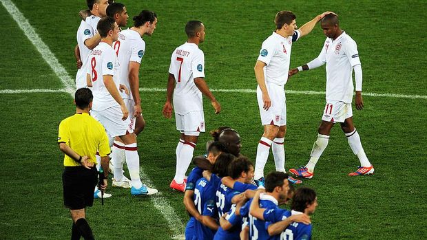 KIEV, UKRAINE - JUNE 24: Ashley Young of England is consoled by Steven Gerrard after his penalty miss the UEFA EURO 2012 quarter final match between England and Italy at The Olympic Stadium on June 24, 2012 in Kiev, Ukraine.  (Photo by Christopher Lee/Getty Images)