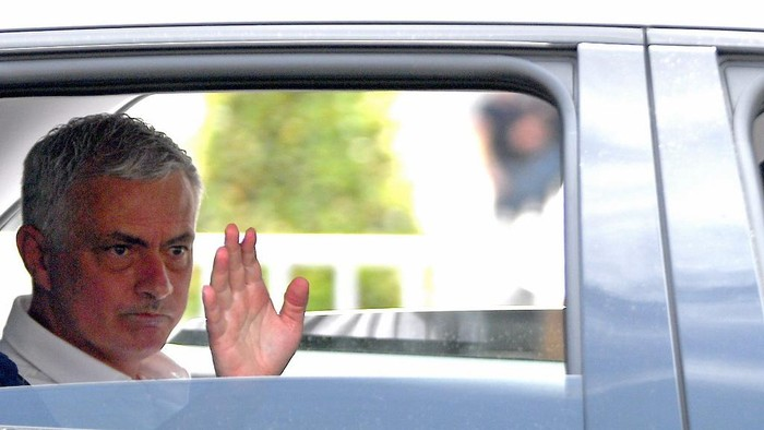 Portuguese football coach Jose Mourinho waves from a car after his official presentation as Roma coach in central Rome on July 8, 2021.