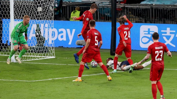 LONDON, ENGLAND - JULY 07: Raheem Sterling of England is fouled by Mathias Jensen of Denmark inside the penalty area, leading to England being awarded a penalty during the UEFA Euro 2020 Championship Semi-final match between England and Denmark at Wembley Stadium on July 07, 2021 in London, England. (Photo by Catherine Ivill/Getty Images)