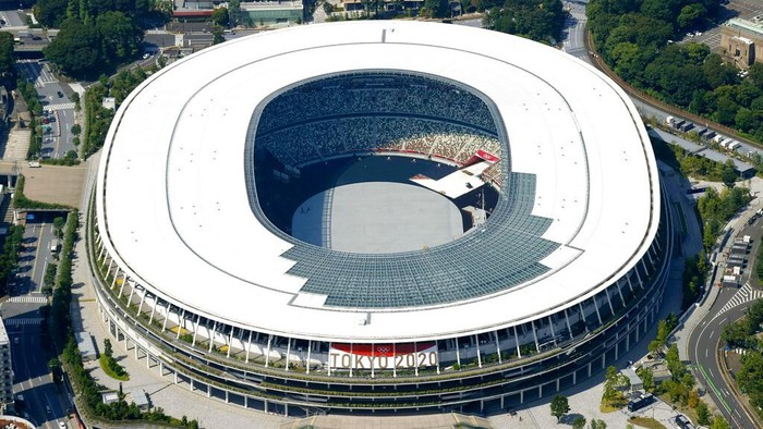 This aerial photo shows the National Stadium in Tokyo, Japan Monday, June 21, 2021. Fans will be banned from Tokyo-area stadiums and arenas when the Olympics begin in two weeks, the city's governor said Thursday after meeting with organizers of the pandemic-postponed games.(Kyodo News via AP)
