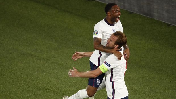 England's Harry Kane, right, celebrates with England's Raheem Sterling after scoring his side's third goal during the Euro 2020 soccer championship quarterfinal match between Ukraine and England at the Olympic stadium in Rome, Italy, Saturday, July 3, 2021. (Alessandro Garofalo/Pool Via AP)