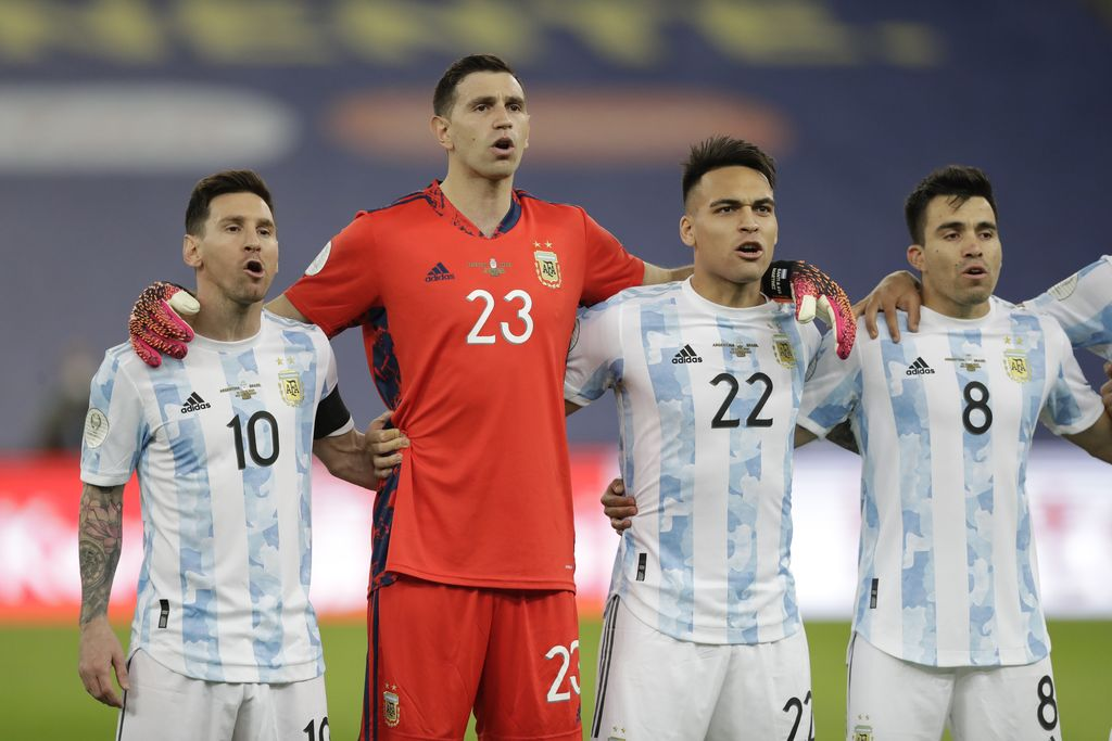 Argentina's players from left: Lionel Messi, goalkeeper Emiliano Martinez, Lautaro Martinez and Marcos Acuna sing their national anthem prior to the Copa America final soccer match against Brazil at the Maracana stadium in Rio de Janeiro, Brazil, Saturday, July 10, 2021. (AP Photo/Andre Penner)