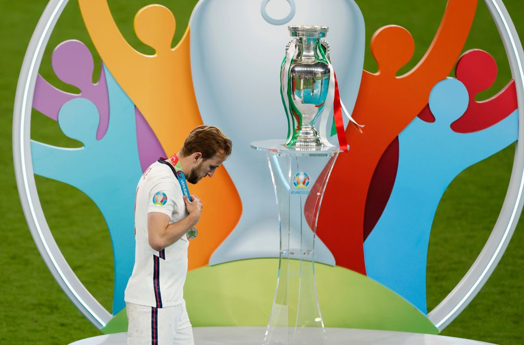 LONDON, ENGLAND - JULY 11: Harry Kane of England walks past the Henri Delaunay Trophy following his team's defeat in the UEFA Euro 2020 Championship Final between Italy and England at Wembley Stadium on July 11, 2021 in London, England. (Photo by John Sibley - Pool/Getty Images)