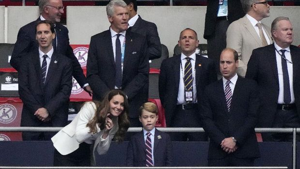 Prince William, his son Prince George and Duchess Catherine, from right, stand on the tribune prior the Euro 2020 soccer championship final between England and Italy at Wembley stadium in London, Sunday, July 11, 2021. (AP Photo/Frank Augstein, Pool)