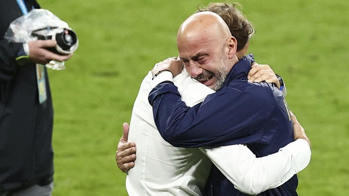 Italy manager Roberto Mancini, left, and Gianluca Vialli, head of the Italian national team celebrate after victory in the penalty shoot out during the Euro 2020 soccer championship final match between England and Italy at Wembley Stadium in London, Sunday, July 11, 2021. (Christian Charisius/dpa via AP)