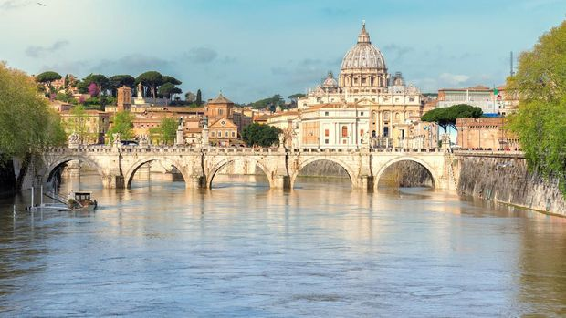 Rome sunset over Tiber and St Peters Basilica Vatican Italy