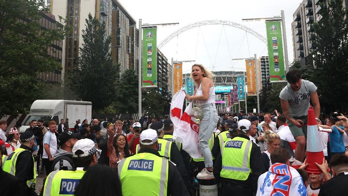 LONDON, ENGLAND - JULY 11: Police walk down Olympic Way during the UEFA Euro 2020 Championship Final between Italy and England at Wembley Stadium on July 11, 2021 in London, England. (Photo by Alex Pantling/Getty Images)