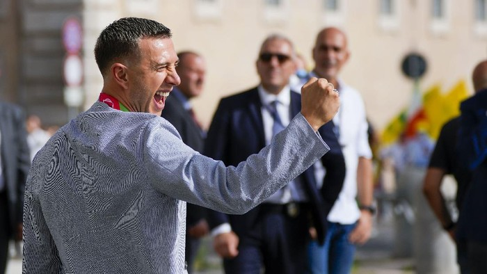 Italys Federico Bernardeschi reacts as he leaves the Quirinale Presidential Palace where he attended with his team a ceremony host by President Sergio Mattarella in Rome, Monday, July 12, 2021, to celebrate their victory of the Euro 2020 soccer championships in a final played at Wembley stadium in London on Sunday. Italy beat England 3-2 in a penalty shootout after a 1-1 draw. (AP Photo/Alessandra Tarantino)