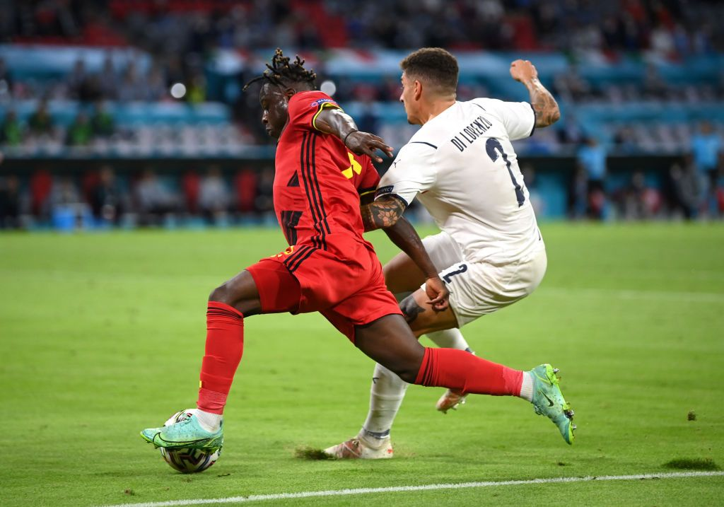 MUNICH, GERMANY - JULY 02: Jeremy Doku of Belgium is fouled by Giovanni Di Lorenzo of Italy leading to a penalty being awarded during the UEFA Euro 2020 Championship Quarter-final match between Belgium and Italy at Football Arena Munich on July 02, 2021 in Munich, Germany. (Photo by Matthias Hangst/Getty Images)