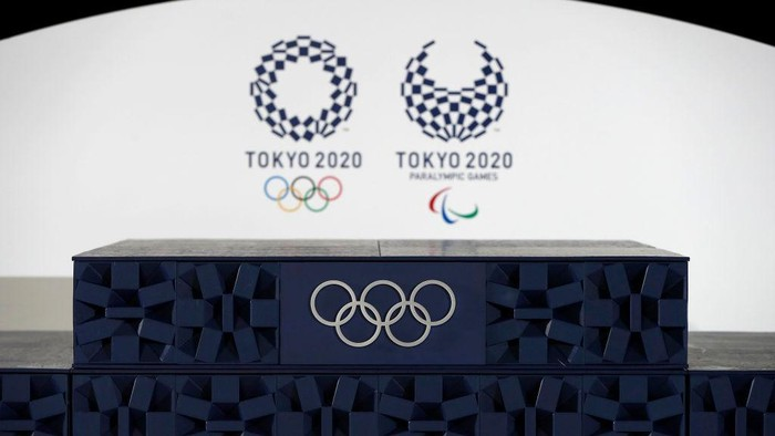 TOKYO, JAPAN - JUNE 03: The Victory podium that will be used during the victory ceremonies at the Tokyo 2020 Olympic Games is displayed during an unveiling event for the victory ceremonies items including podium, music, costume and medal tray for the Olympic and Paralympic games at the Ariake Arena on the day marking the 50 days to go to the Tokyo Olympic Games opening ceremony on June 3, 2021 in Tokyo, Japan. (Photo by Issei Kato - Pool/Getty Images)