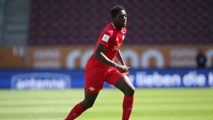 AUGSBURG, GERMANY - JUNE 27: Ibrahima Konate of Leipzig runs with the ball during the Bundesliga match between FC Augsburg and RB Leipzig at WWK-Arena on June 27, 2020 in Augsburg, Germany. (Photo by Alexander Hassenstein/Getty Images)