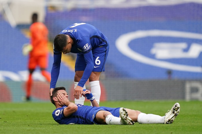 LONDON, ENGLAND - APRIL 03: Thiago Silva of Chelsea checks on teammate Cesar Azpilicueta as he reacts with an injury during the Premier League match between Chelsea and West Bromwich Albion at Stamford Bridge on April 03, 2021 in London, England. Sporting stadiums around the UK remain under strict restrictions due to the Coronavirus Pandemic as Government social distancing laws prohibit fans inside venues resulting in games being played behind closed doors. (Photo by John Walton - Pool/Getty Images)