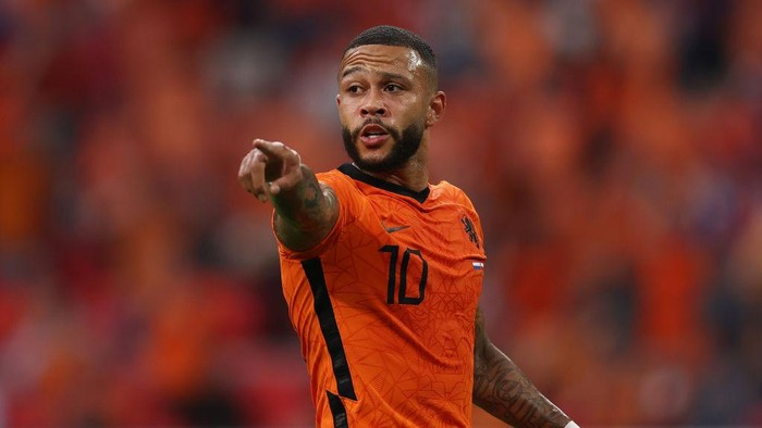 AMSTERDAM, NETHERLANDS - JUNE 17: Memphis Depay of Netherlands reacts during the UEFA Euro 2020 Championship Group C match between the Netherlands and Austria at Johan Cruijff Arena on June 17, 2021 in Amsterdam, Netherlands. (Photo by Dean Mouhtaropoulos/Getty Images)