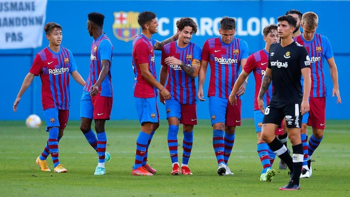 BARCELONA, SPAIN - JULY 21: Alex Collado of FC Barcelona celebrates scoring a goal with team mates during a friendly match between FC Barcelona and Gimnastic de Tarragona at Johan Cruyff Stadium on July 21, 2021 in Barcelona, Spain. (Photo by Eric Alonso/Getty Images)