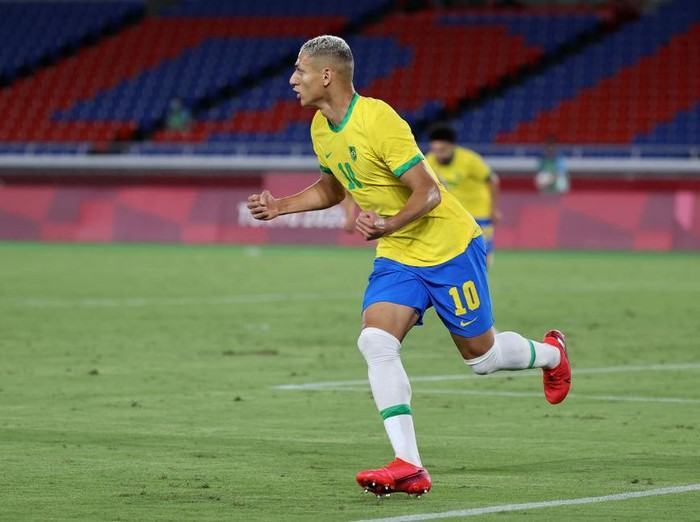 YOKOHAMA, JAPAN - JULY 22: Richarlison #10 of Team Brazil celebrates after scoring their sides first goal during the Mens First Round Group D match between Brazil and Germany during the Tokyo 2020 Olympic Games at International Stadium Yokohama on July 22, 2021 in Yokohama, Tokyo, Japan. (Photo by Toru Hanai/Getty Images)