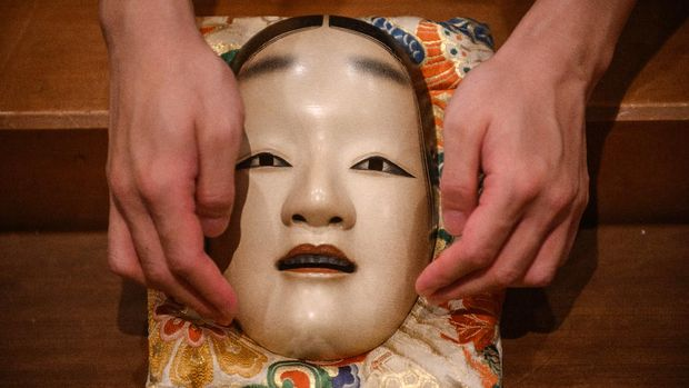 This photo taken on July 29, 2020 shows a mask displayed at the Kamakura Noh Theatre in the town of Kamakura in Kanagawa Prefecture, about one hour southwest of Tokyo. - The COVID-19 coronavirus pandemic has affected theatres across the world, but noh performers now face the ultimate question -- can the play that has been passed down for generations since the 14th century still survive after the pandemic? (Photo by Philip FONG / AFP) / TO GO WITH Japan-theatre-noh-virus-health, FOCUS by Natsuko FUKUE