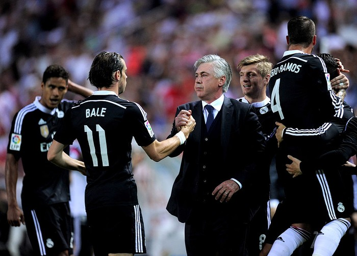 SEVILLE, SPAIN - MAY 02:  Head coach Carlo Ancelott of Real Madrid celebrates with Gareth Bale after Cristiano Ronaldo scored his teams 3rd goal during the La Liga match between Sevilla FC and Real Madrid CF at Estadio Ramon Sanchez Pizjuan on May 2, 2015 in Seville, Spain.  (Photo by Denis Doyle/Getty Images)