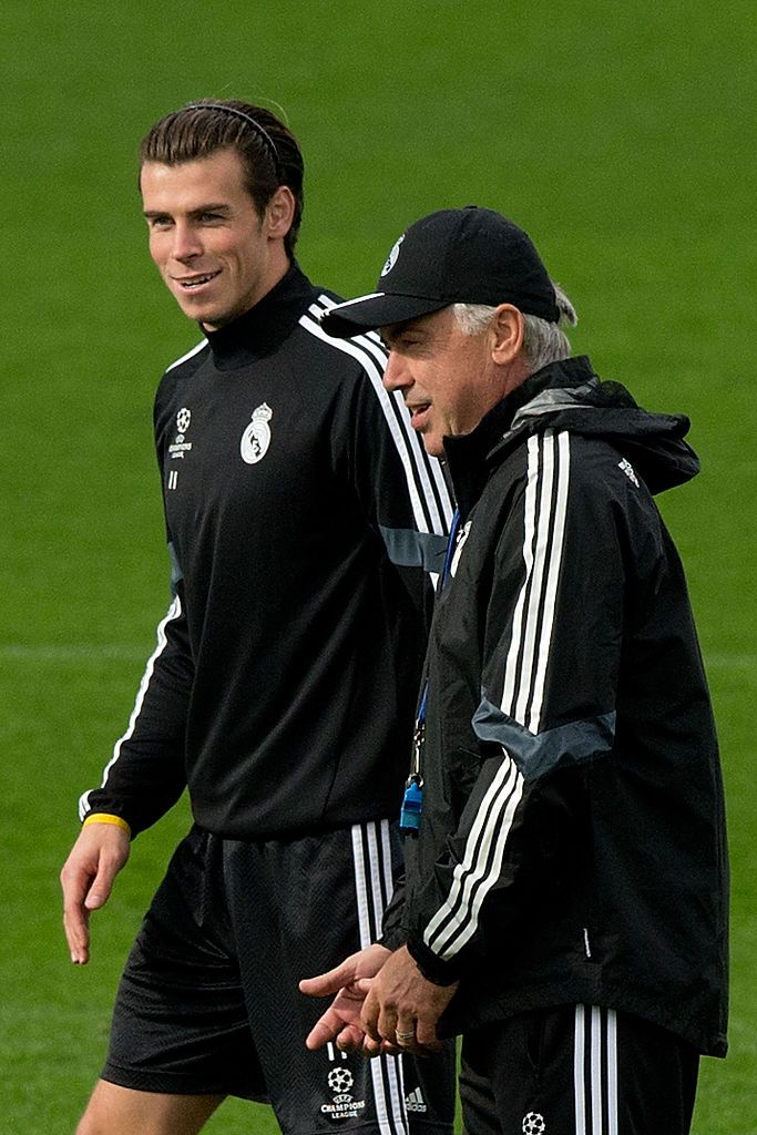 SEVILLE, SPAIN - MAY 02:  Head coach Carlo Ancelott of Real Madrid celebrates with Gareth Bale after Cristiano Ronaldo scored his team's 3rd goal during the La Liga match between Sevilla FC and Real Madrid CF at Estadio Ramon Sanchez Pizjuan on May 2, 2015 in Seville, Spain.  (Photo by Denis Doyle/Getty Images)