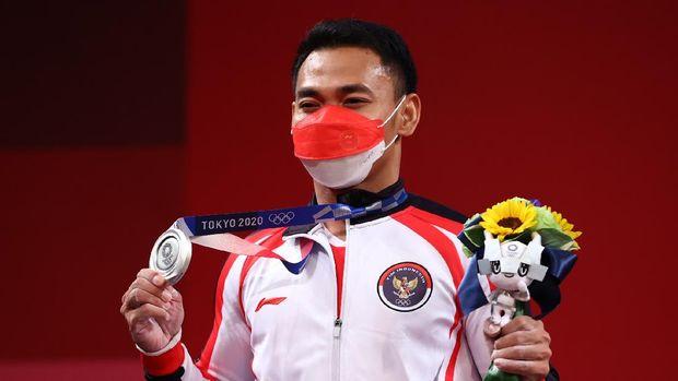 Tokyo 2020 Olympics - Weightlifting - Men's 61kg - Medal Ceremony - Tokyo International Forum, Tokyo, Japan - July 25, 2021. Silver medalist Eko Yuli Irawan of Indonesia reacts. REUTERS/Edgard Garrido
