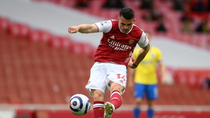 LONDON, ENGLAND - MAY 23: GranitXhaka of Arsenal takes a shot during the Premier League match between Arsenal and Brighton & Hove Albion at Emirates Stadium on May 23, 2021 in London, England. A limited number of fans will be allowed into Premier League stadiums as Coronavirus restrictions begin to ease in the UK. (Photo by Mike Hewitt/Getty Images)
