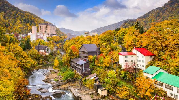 Jozankei, Japan inns and river skyline during the autumn.