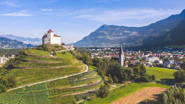 Balzers, Liechtenstein - September 2020: Burg Gutenberg, intact medieval castle and a church on a hilltop
