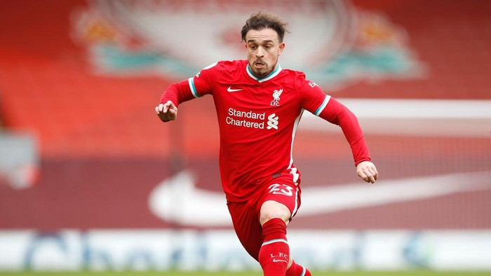 LIVERPOOL, ENGLAND - MARCH 07: Xherdan Shaqiri of Liverpool runs with the ball during the Premier League match between Liverpool and Fulham at Anfield on March 07, 2021 in Liverpool, England. Sporting stadiums around the UK remain under strict restrictions due to the Coronavirus Pandemic as Government social distancing laws prohibit fans inside venues resulting in games being played behind closed doors. (Photo by Phil Noble - Pool/Getty Images)