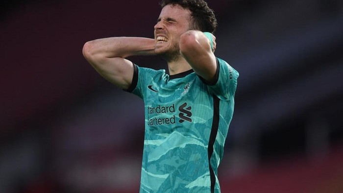 MANCHESTER, ENGLAND - MAY 13: Diogo Jota of Liverpool reacts during the Premier League match between Manchester United and Liverpool at Old Trafford on May 13, 2021 in Manchester, England. Sporting stadiums around the UK remain under strict restrictions due to the Coronavirus Pandemic as Government social distancing laws prohibit fans inside venues resulting in games being played behind closed doors. (Photo by Michael Regan/Getty Images)