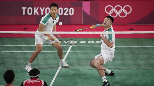 Taiwan's Lee Yang and Wang Chi-Lin play against Indonesia's Marcus Gideon and Kevin Sanjaya Sukamuljo during their men's doubles group play stage badminton match at the 2020 Summer Olympics, Tuesday, July 27, 2021, in Tokyo, Japan. (AP Photo/Dita Alangkara)