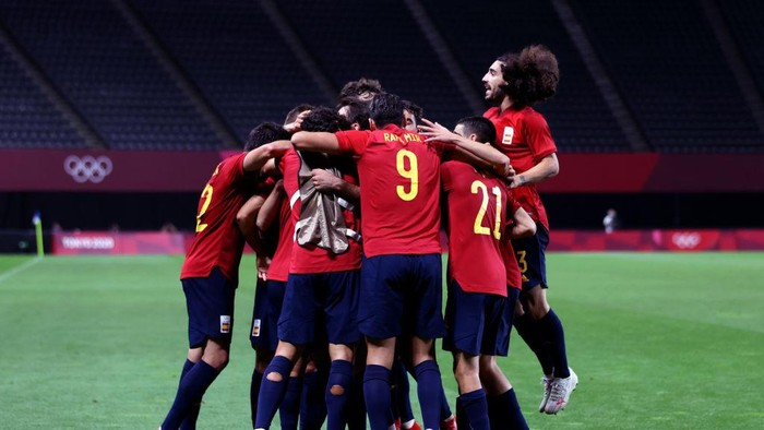 SAPPORO, JAPAN - JULY 25: Mikel Oyarzabal #11 (Hidden) of Team Spain celebrates with teammates after scoring their sides first goal during the Mens First Round Group C match between Australia and Spain on day two of the Tokyo 2020 Olympic Games at Sapporo Dome on July 25, 2021 in Sapporo, Hokkaido, Japan. (Photo by Masashi Hara/Getty Images)