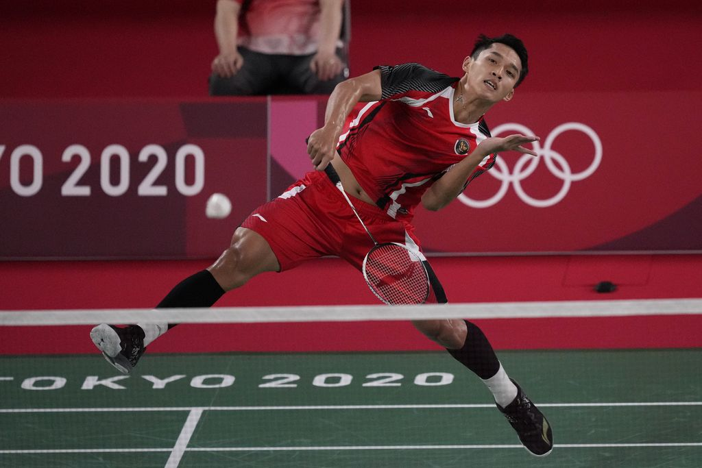 Indonesia's Anthony Sinisuka Ginting competes against Hungary's Gergely Krausz during their men's singles badminton match at the 2020 Summer Olympics, Sunday, July 25, 2021, in Tokyo, Japan. (AP Photo/Markus Schreiber)