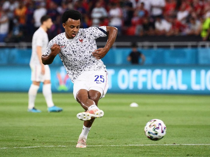 BUDAPEST, HUNGARY - JUNE 23: Jules Kounde of France shoots during the warm up prior to the UEFA Euro 2020 Championship Group F match between Portugal and France at Puskas Arena on June 23, 2021 in Budapest, Hungary. (Photo by Franck Fife - Pool/Getty Images)