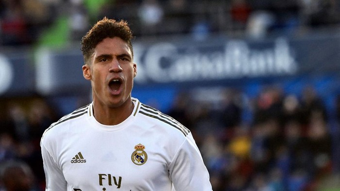 (FILES) In this file photo taken on January 04, 2020 Real Madrids French defender Raphael Varane celebrates his goal during the Spanish league football match between Getafe CF and Real Madrid CF at the Col. Alfonso Perez stadium in Getafe on January 4, 2020. - Manchester United have agreed a deal to sign France defender Raphael Varane from Real Madrid, according to several British media reports on July 27, 2021. Varane had been a longstanding target for United, who last week completed the transfer of England winger Jadon Sancho from German club Borussia Dortmund for a reported 73 million ($100 million). Ole Gunnar Solskjaers men are now closing in on the signing of Real centre-back Varane, having agreed a deal worth a reported 34million rising to 42million with add-ons. (Photo by OSCAR DEL POZO / AFP)