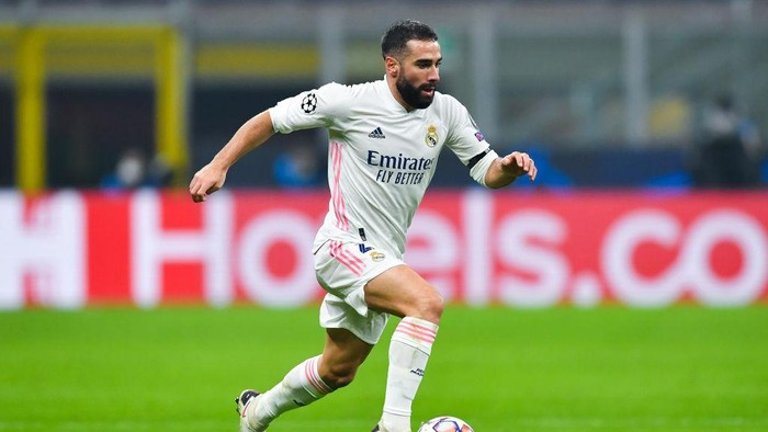 MILAN, ITALY - NOVEMBER 25: Daniel Carvajal of Real Madrid runs with the ball during the UEFA Champions League Group B stage match between FC Internazionale and Real Madrid at Stadio Giuseppe Meazza on November 25, 2020 in Milan, Italy. Football Stadiums around Europe remain empty due to the Coronavirus Pandemic as Government social distancing laws prohibit fans inside venues resulting in fixtures being played behind closed doors. (Photo by Valerio Pennicino/Getty Images)