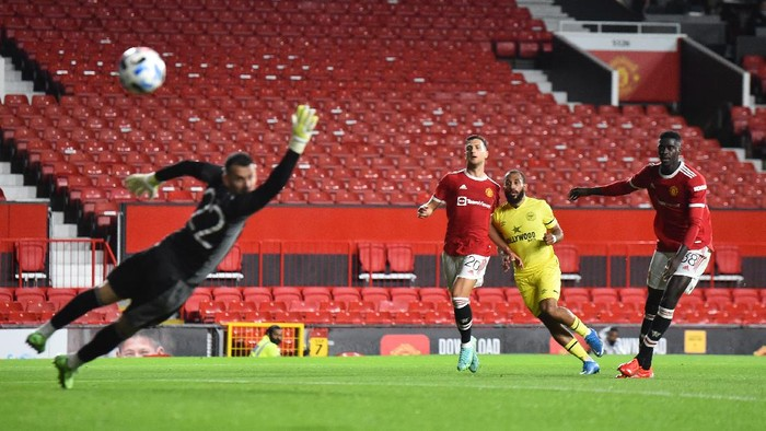 MANCHESTER, ENGLAND - JULY 28: Bryan Mbeumo of Brentford scores their second goal during the pre-season friendly match between Manchester United and Brentford at Old Trafford on July 28, 2021 in Manchester, England. (Photo by Nathan Stirk/Getty Images)