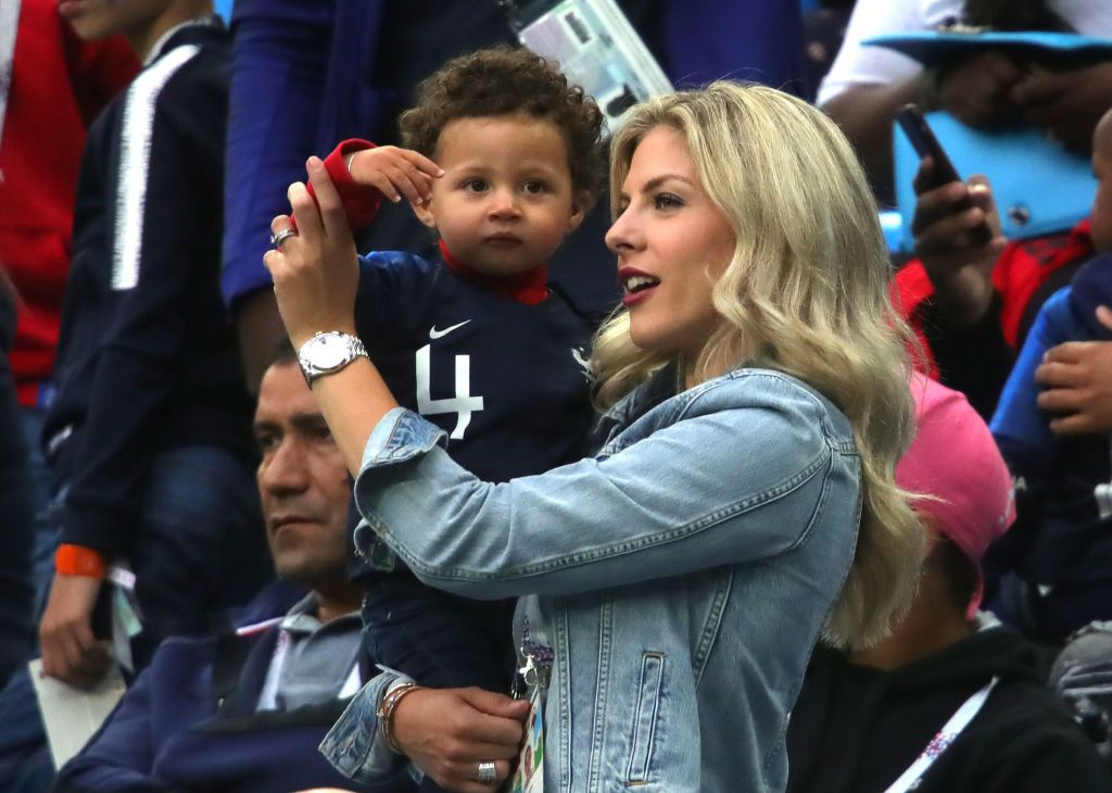 SAINT PETERSBURG, RUSSIA - JULY 10:  Raphael Varane's wife Camille Tytgat and son Ruben attend the 2018 FIFA World Cup Russia Semi Final match between Belgium and France at Saint Petersburg Stadium on July 10, 2018 in Saint Petersburg, Russia.  (Photo by Alexander Hassenstein/Getty Images)