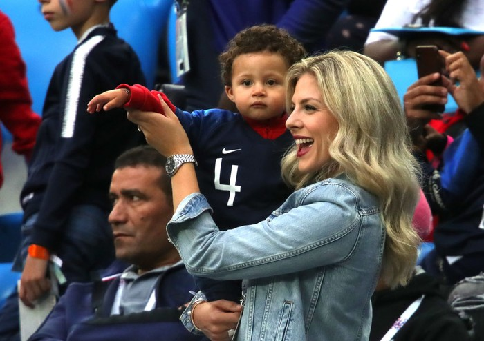 SAINT PETERSBURG, RUSSIA - JULY 10:  Raphael Varanes wife Camille Tytgat and son Ruben attend the 2018 FIFA World Cup Russia Semi Final match between Belgium and France at Saint Petersburg Stadium on July 10, 2018 in Saint Petersburg, Russia.  (Photo by Alexander Hassenstein/Getty Images)