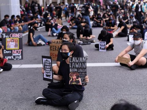 Malaysians take part in a rare anti-government rally in Kuala Lumpur on July 31, 2021, despite a tough Covid-19 coronavirus lockdown in place restricting gatherings and public assemblies. (Photo by Arif KARTONO / AFP)