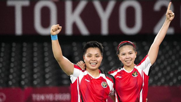 Indonesia's Greysia Polii, right, and Apriyani Rahayu celebrate after winning against South Korea's Lee Sohee and Shin Seungchan their women's semifinal badminton match at the 2020 Summer Olympics, Saturday, July 31, 2021, in Tokyo, Japan. (AP Photo/Markus Schreiber)