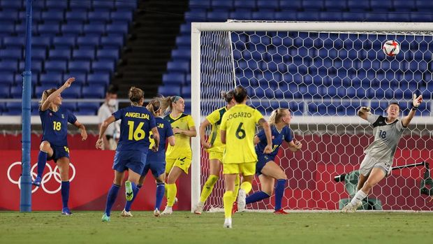YOKOHAMA, JAPAN - AUGUST 02: Fridolina Rolfo #18 of Team Sweden scores their side's first goal past Teagan Micah #18 of Team Australia during the Women's Semi-Final match between Australia and Sweden on day ten of the Tokyo 2020 Olympic Games at International Stadium Yokohama on August 2, 2021 in Yokohama, Japan. (Photo by David Ramos/Getty Images)