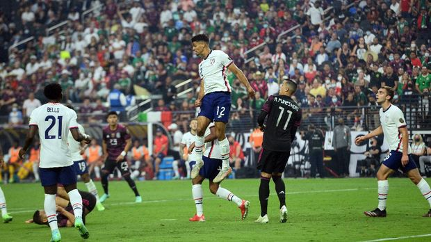 Aug 1, 2021; Las Vegas, Nevada, USA; the United States defender Miles Robinson (12) heads the ball against the Mexico during the first half of the CONCACAF Gold Cup final soccer match at Allegiant Stadium. Mandatory Credit: Joe Camporeale-USA TODAY Sports