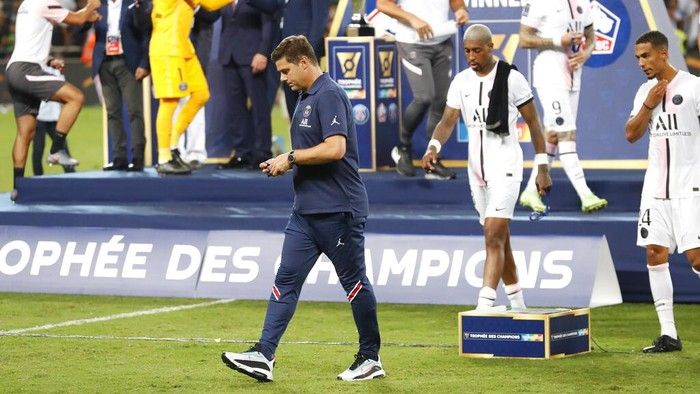 PSGs head coach Mauricio Pochettino walks after loosing the French Super Cup final soccer match between Lille and Paris Saint-Germain at Bloomfield Stadium in Tel Aviv, Israel, Sunday, Aug. 1, 2021. (AP Photo/Ariel Schalit)